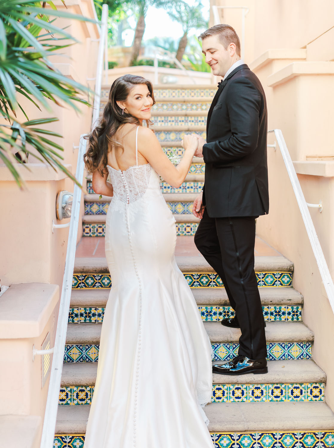 Bride walking with groom up stairs that have mosaic color tile in between each step, Intimate Wedding at La Valencia Hotel in La Jolla by Cavin Elizabeth Photography