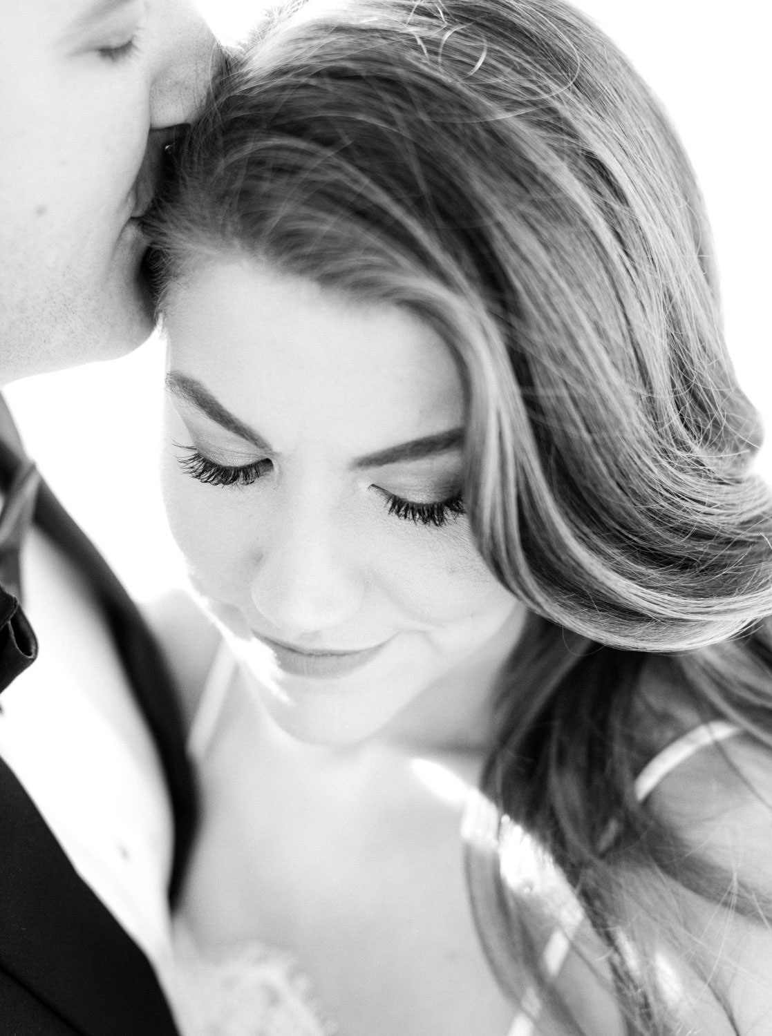 Timeless stunning black and white image of bridal makeup with groom kissing bride on her head, Intimate Wedding at La Valencia Hotel in La Jolla by Cavin Elizabeth Photography