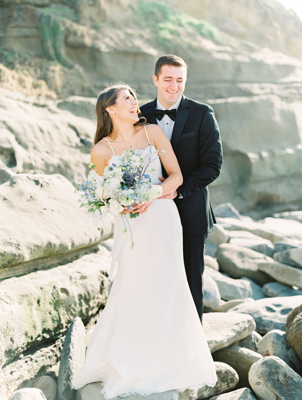 Bride and groom on the rocks of La Jolla shores during low tide, Intimate Wedding at La Valencia Hotel in La Jolla by Cavin Elizabeth Photography