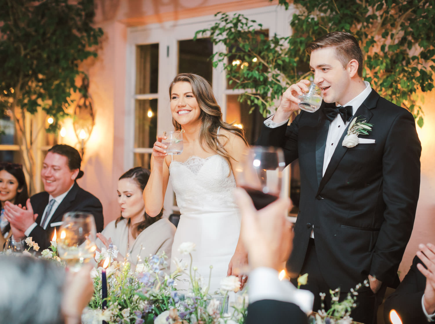 Bride and groom at their wedding reception on a private patio with 26 of their guests. Intimate Wedding at La Valencia Hotel in La Jolla by Cavin Elizabeth Photography