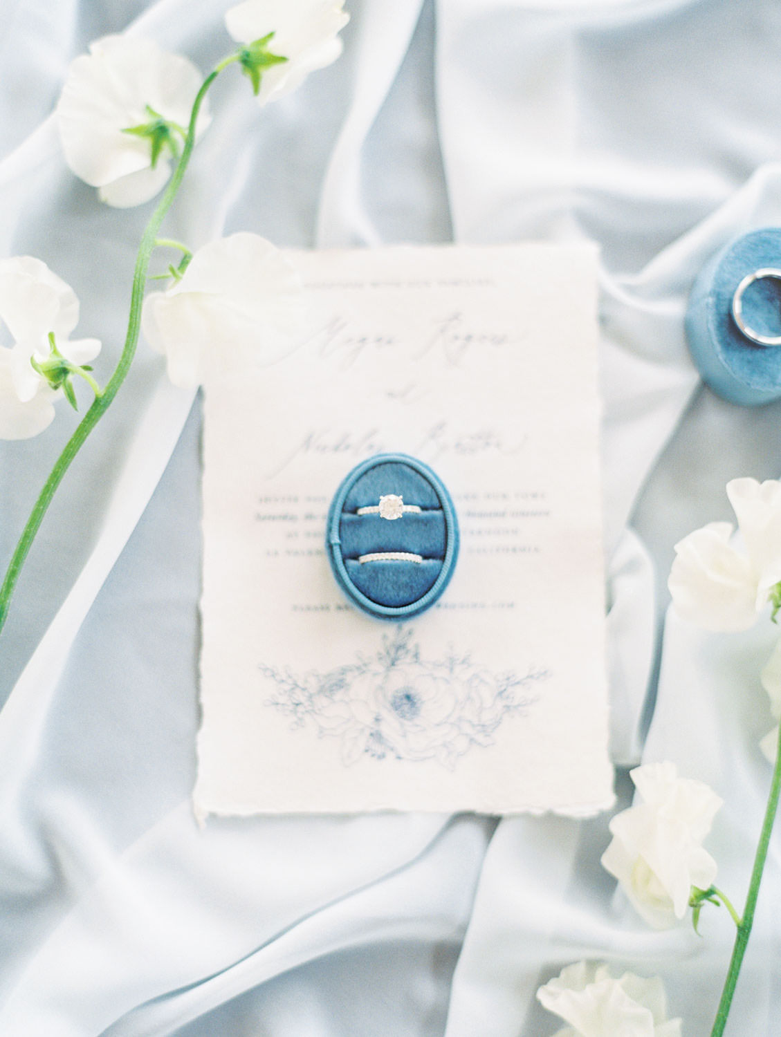 White hand torn wedding invitation stationery with navy blue calligraphy wrapped in twine, Intimate Wedding at La Valencia Hotel in La Jolla by Cavin Elizabeth Photography