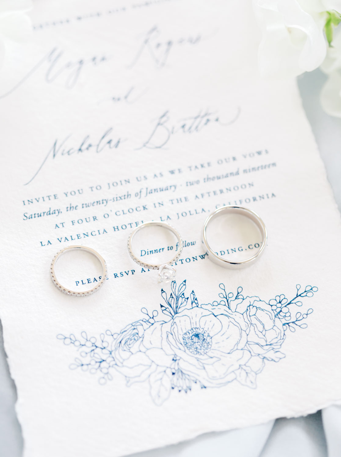 White hand torn wedding invitation stationery with rings on top, Intimate Wedding at La Valencia Hotel in La Jolla by Cavin Elizabeth Photography