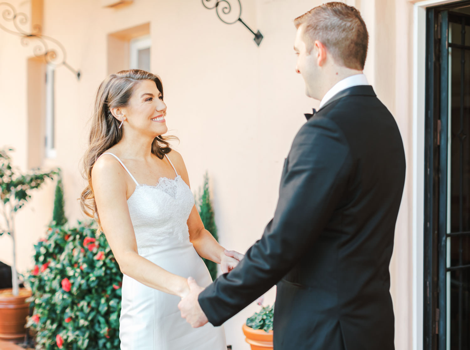 Bride and groom smiling after first look in front of pink walls, Intimate Wedding at La Valencia Hotel in La Jolla by Cavin Elizabeth Photography