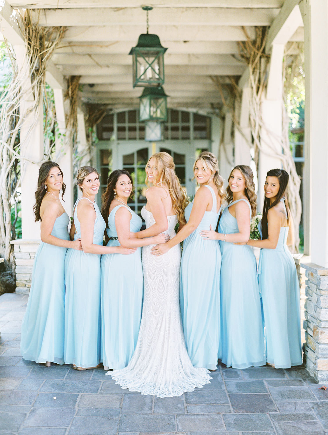 Bride surrounded by bridesmaids wearing pale blue gowns shot on film, Del Mar Country Club Wedding by Cavin Elizabeth Photography