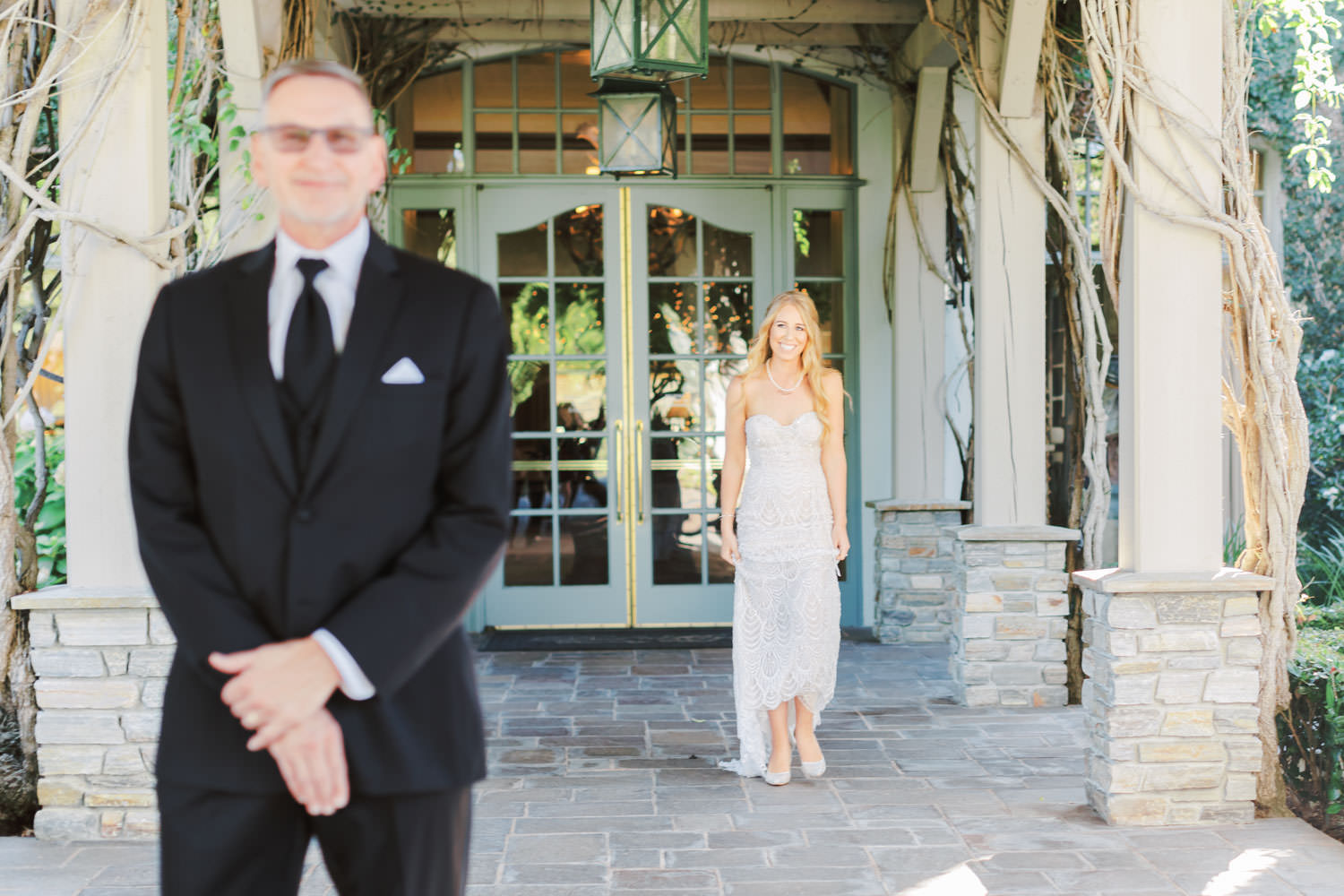 Bride during father daughter first look wearing sweetheart neckline Galia Lahav beaded gown, Del Mar Country Club Wedding by Cavin Elizabeth Photography