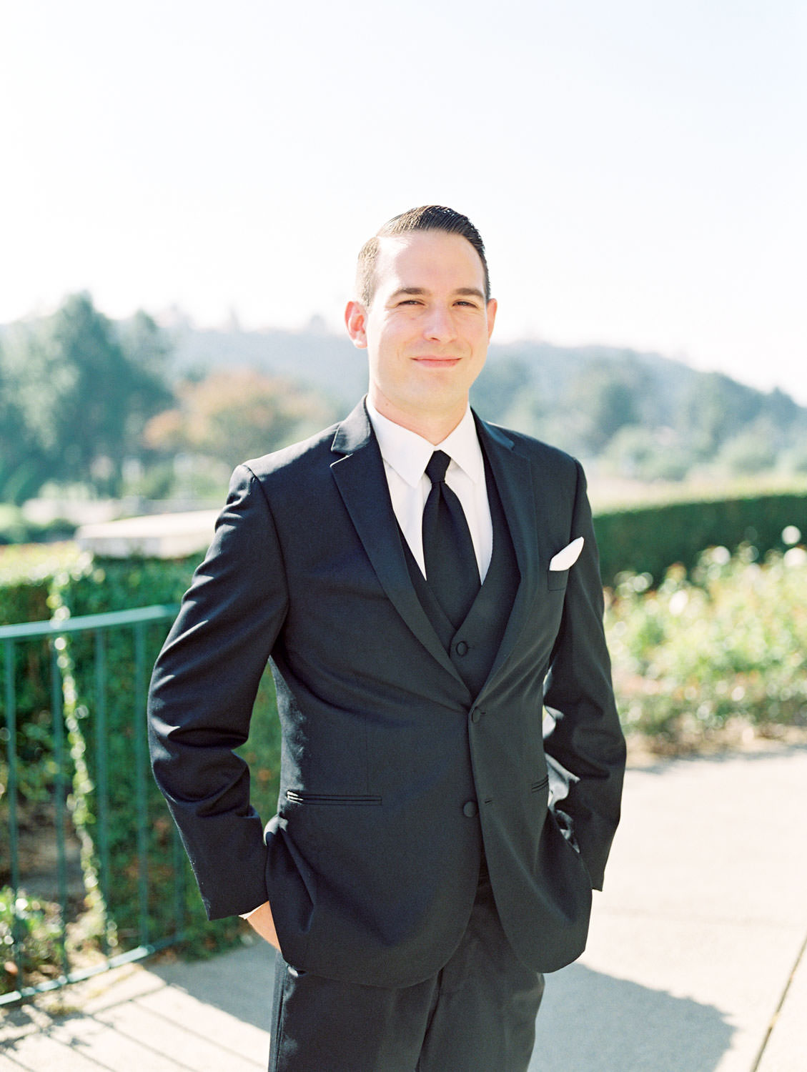 Portrait on film of a groom in a black tuxedo with vest, Del Mar Country Club Wedding by Cavin Elizabeth Photography