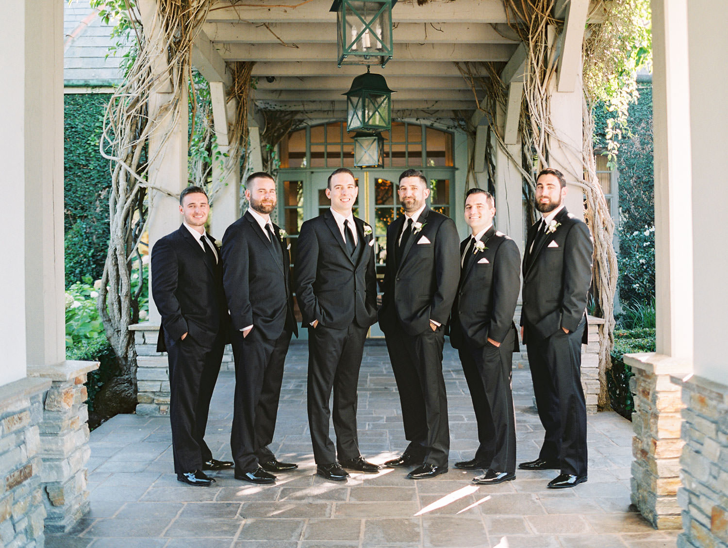 Portrait of groom with groomsmen in a black tuxedo with vest, Del Mar Country Club Wedding by Cavin Elizabeth Photography