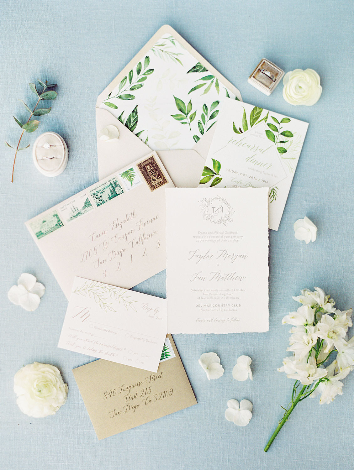 Taupe wedding envelope with greenery envelope liner. Ivory letterpress invitations, styled with white and green blooms and wedding rings in velvet ring boxes, Del Mar Country Club Wedding by Cavin Elizabeth Photography