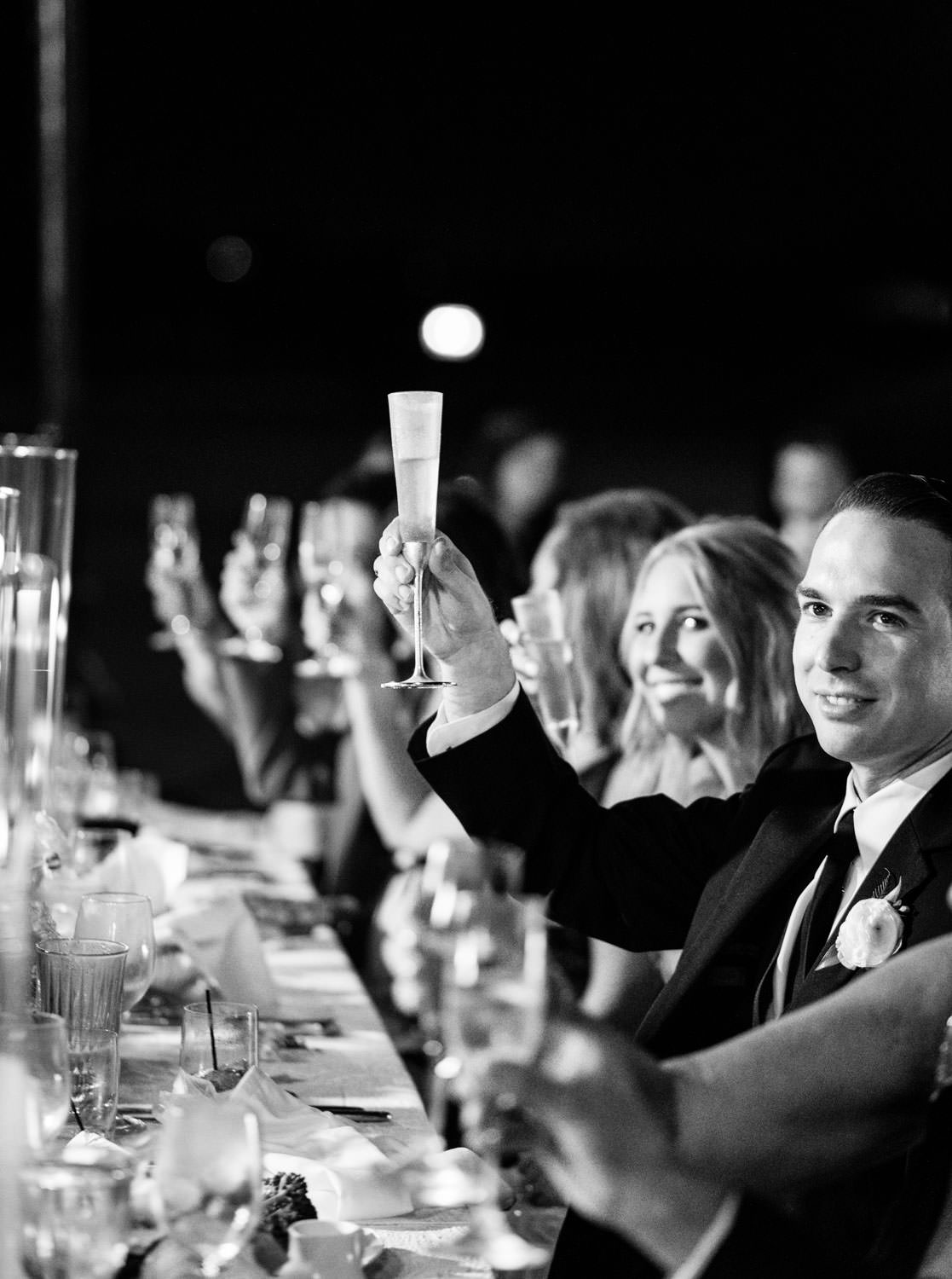 Reception photo of bride and groom during toasts in black and white. Del Mar Country Club Wedding by Cavin Elizabeth Photography