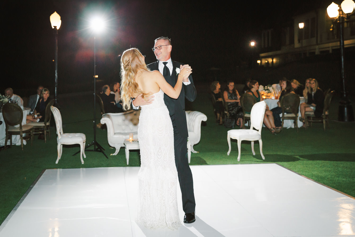 Nighttime al fresco reception featuring father daughter first dance. Del Mar Country Club Wedding by Cavin Elizabeth Photography