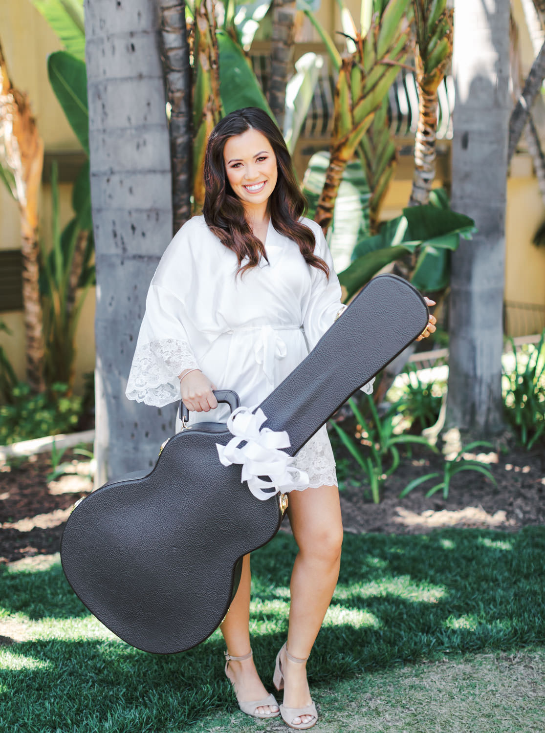 Bride gifted the groom a guitar for the wedding day. Wedding at Humphreys Half Moon Inn by Cavin Elizabeth Photography