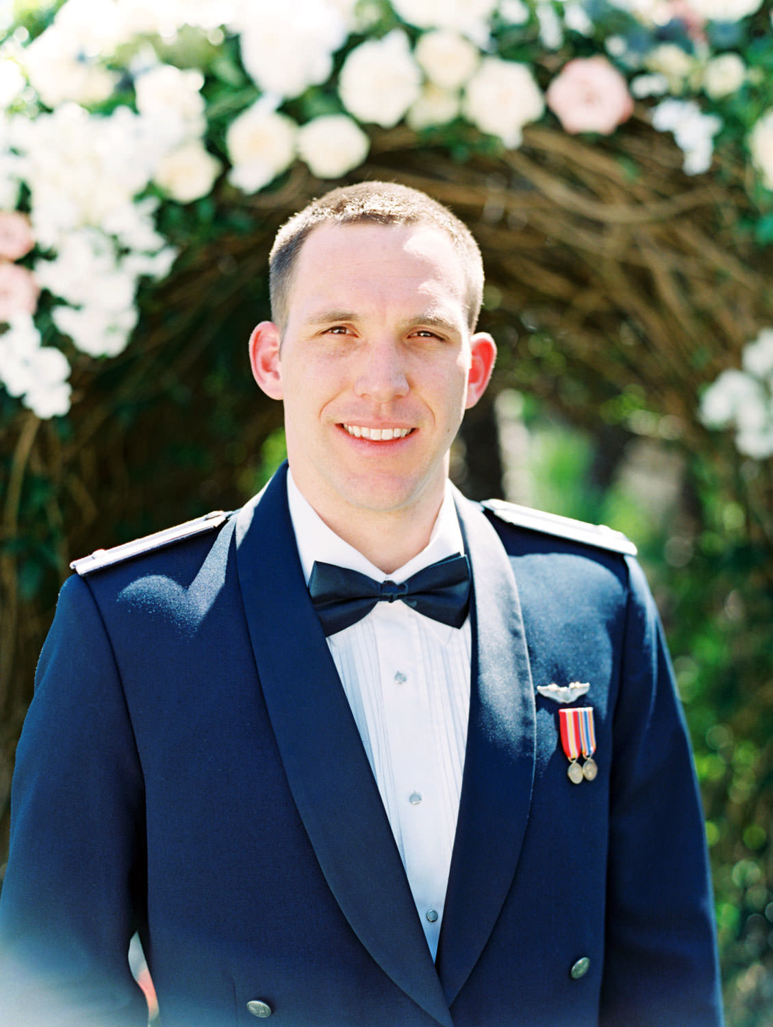 Groom wearing Air Force suit for his wedding on film. Wedding at Humphreys Half Moon Inn by Cavin Elizabeth Photography