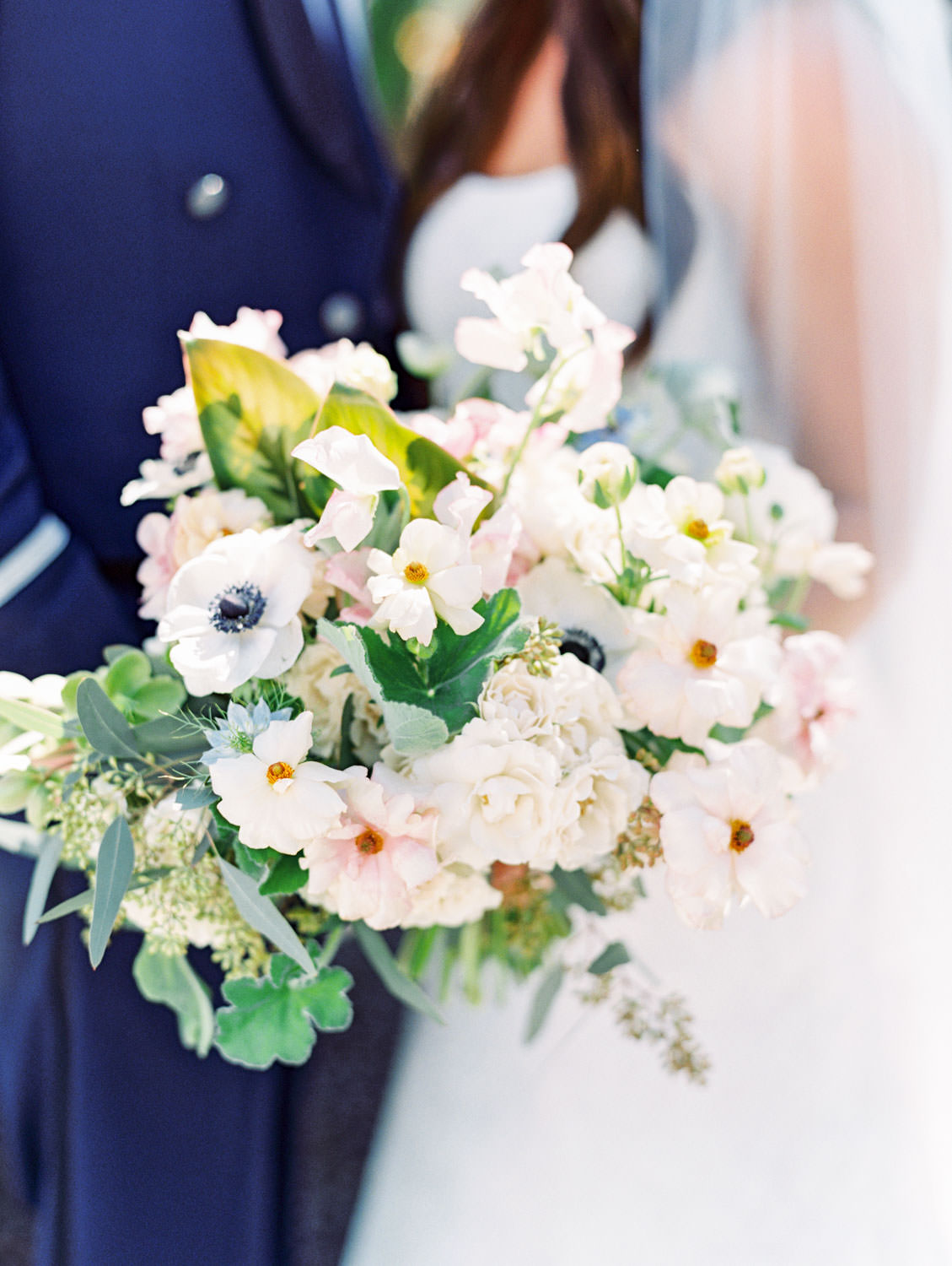 Bride's bouquet with anemones, greenery, and roses captured on film. Wedding at Humphreys Half Moon Inn by Cavin Elizabeth Photography
