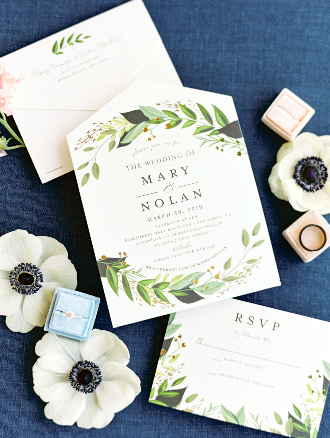Solitaire engagement ring in blue velvet ring box surrounded by anemones and ivory and green invitation on film, Wedding at Humphreys Half Moon Inn by Cavin Elizabeth Photography