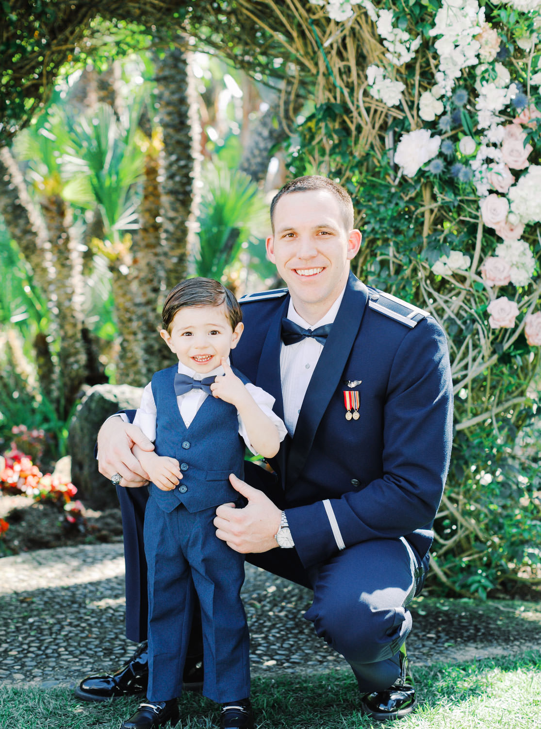 Groom in air force tuxedo with ring bearer in a little navy tux vest. Wedding at Humphreys Half Moon Inn by Cavin Elizabeth Photography