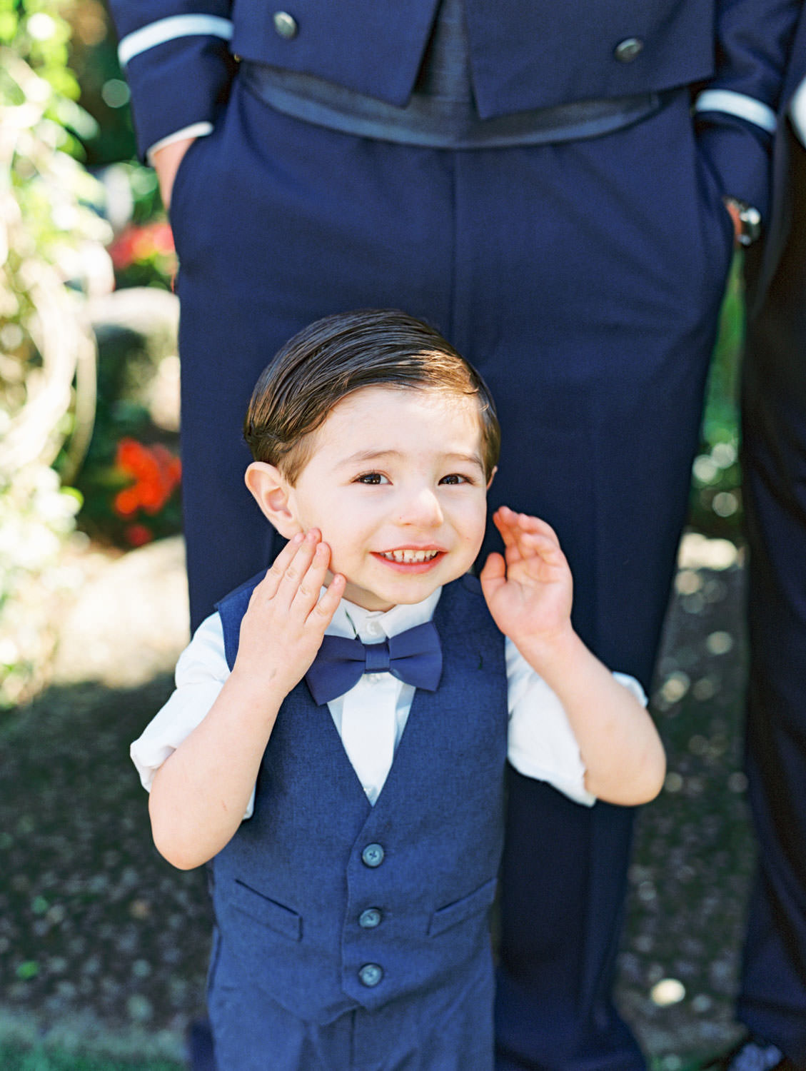 Ring bearer in a little navy tux vest captured on film. Wedding at Humphreys Half Moon Inn by Cavin Elizabeth Photography