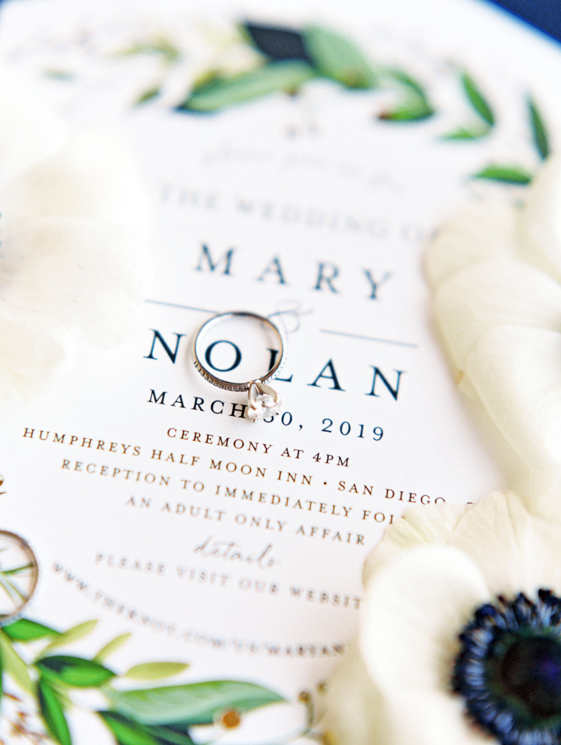 Solitaire engagement ring surrounded by anemones and ivory and green invitation on film, Wedding at Humphreys Half Moon Inn by Cavin Elizabeth Photography