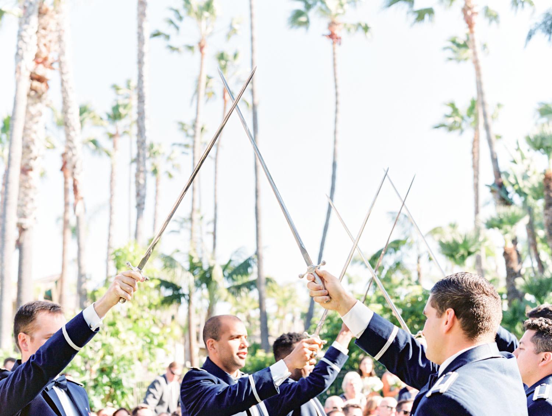 Wedding ceremony Air Force saber arch. Wedding at Humphreys Half Moon Inn by Cavin Elizabeth Photography