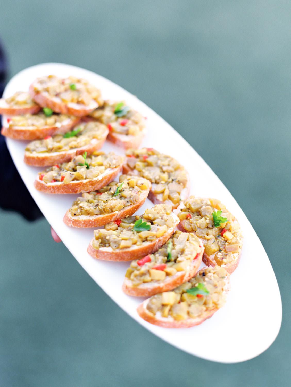 Wedding tray pass appetizer bruschetta captured on film. Wedding at Humphreys Half Moon Inn by Cavin Elizabeth Photography
