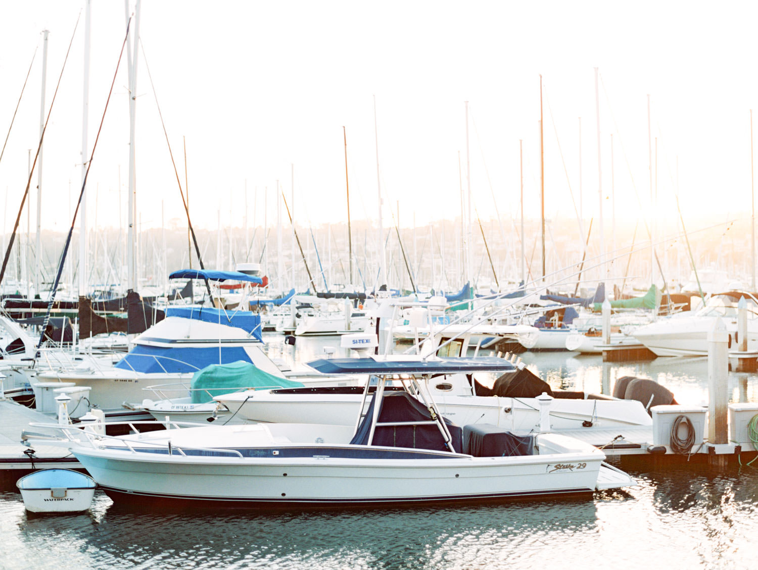 Marina boats during sunset captured on film. Wedding at Humphreys Half Moon Inn by Cavin Elizabeth Photography