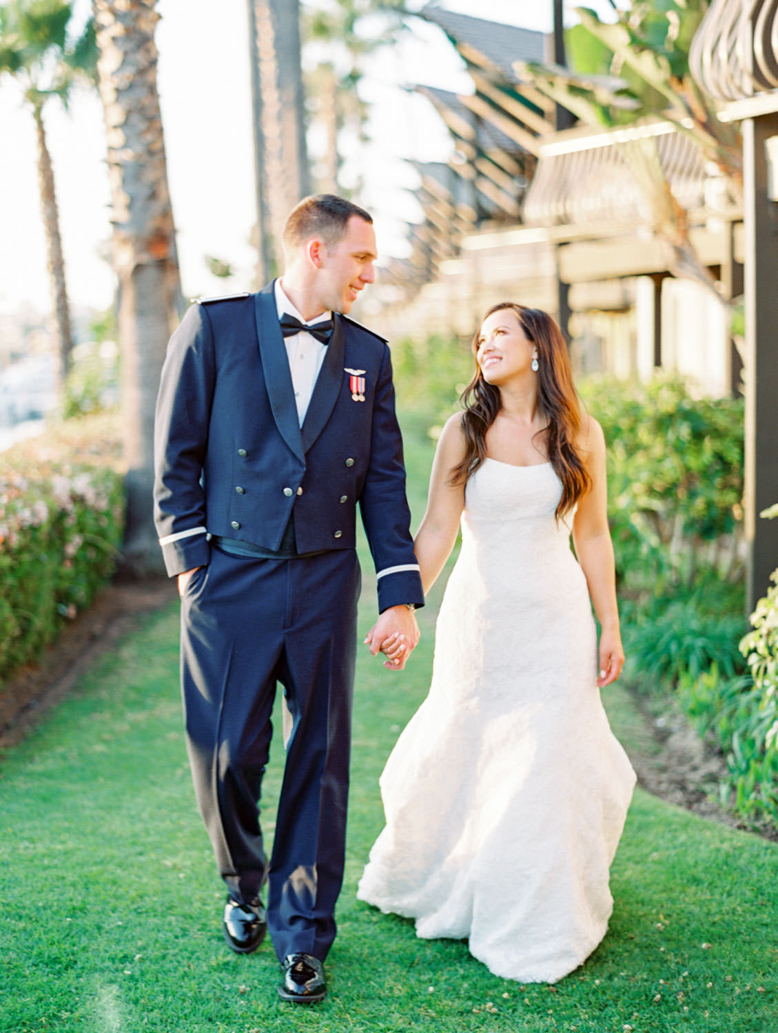 Bride and groom walking during sunset captured on film. Wedding at Humphreys Half Moon Inn by Cavin Elizabeth Photography