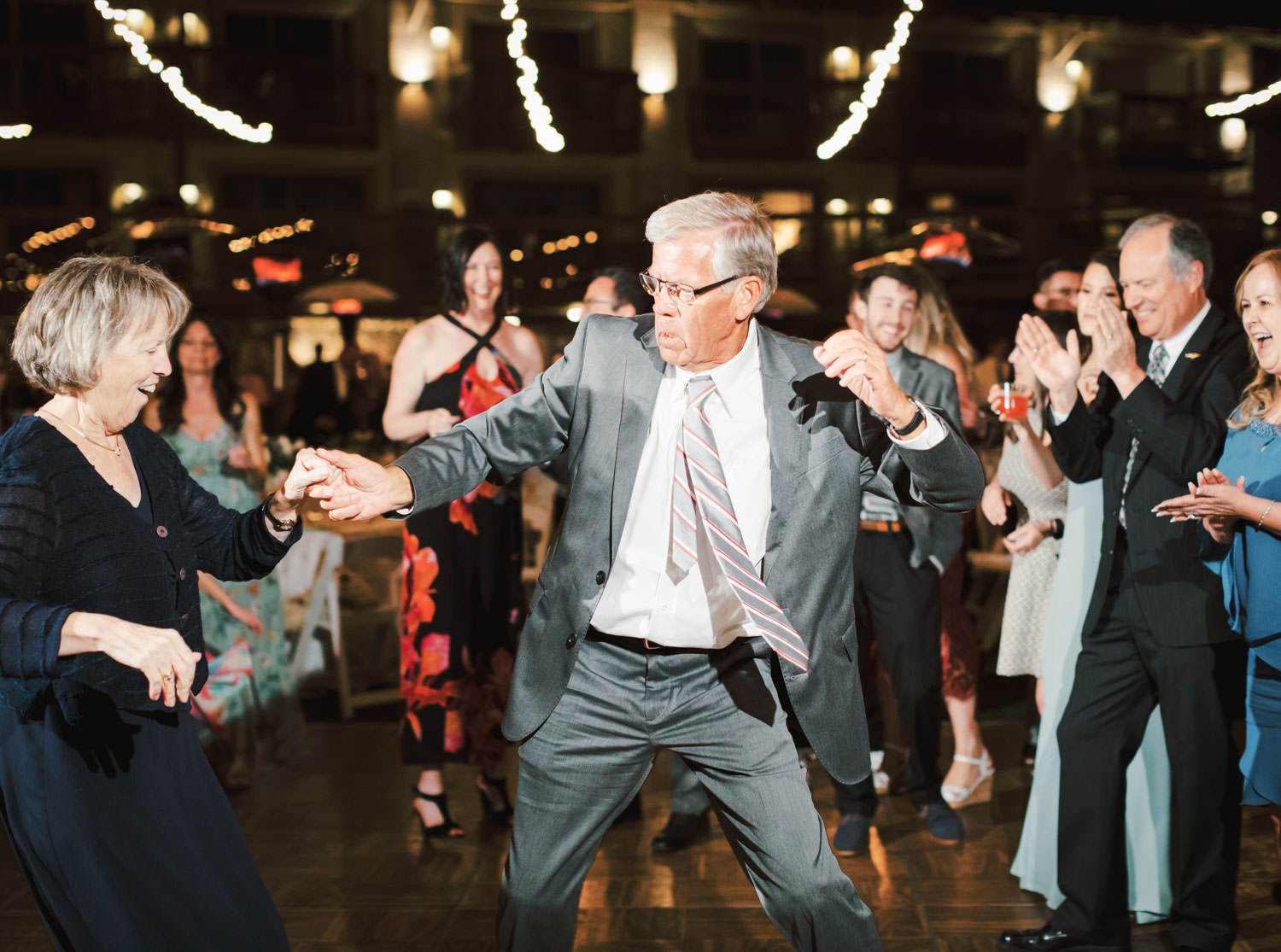 Older guests dancing during a wedding reception at Humphreys Half Moon Inn by Cavin Elizabeth Photography