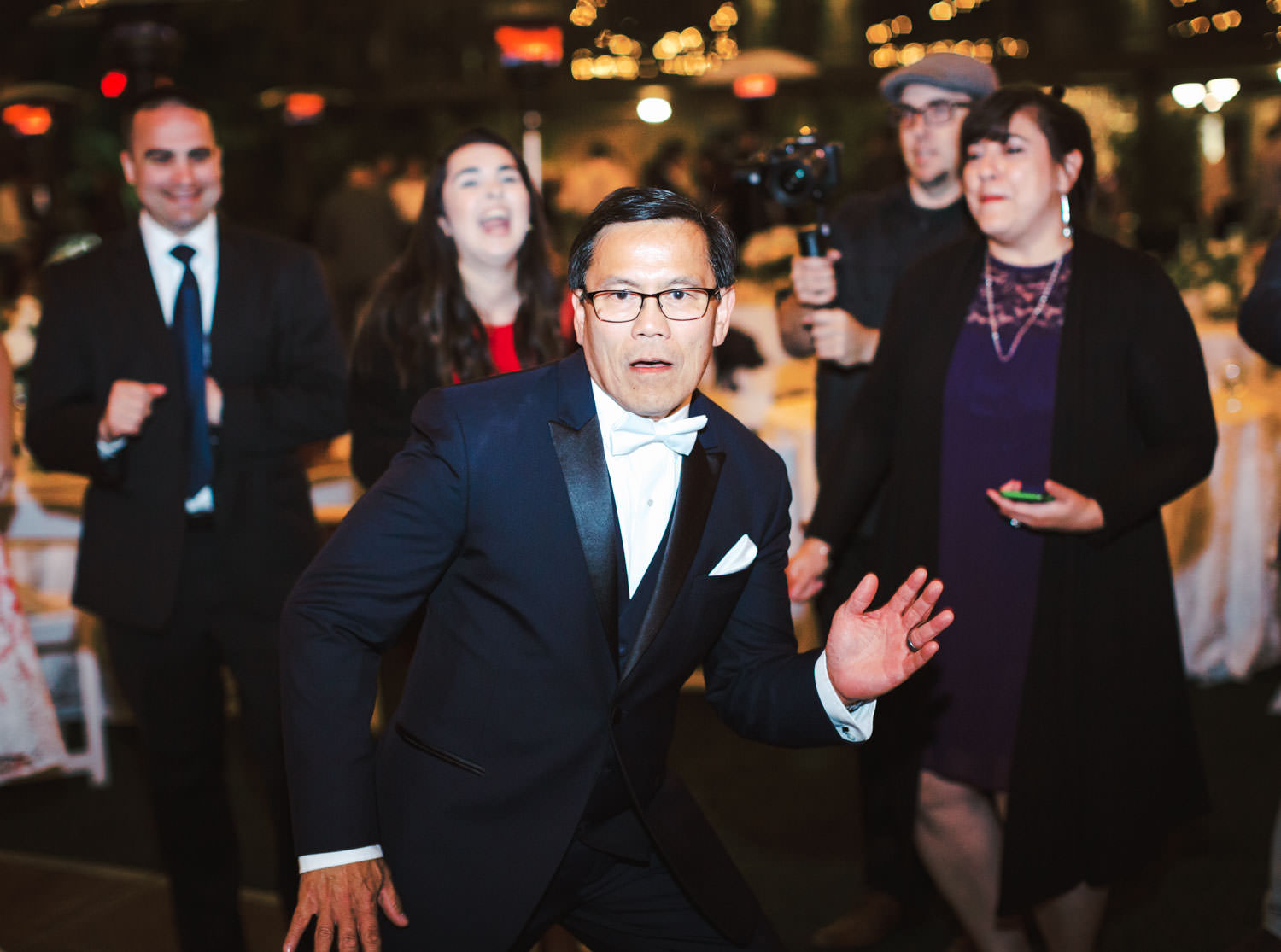 Father of the bride dancing during a wedding reception at Humphreys by Cavin Elizabeth Photography