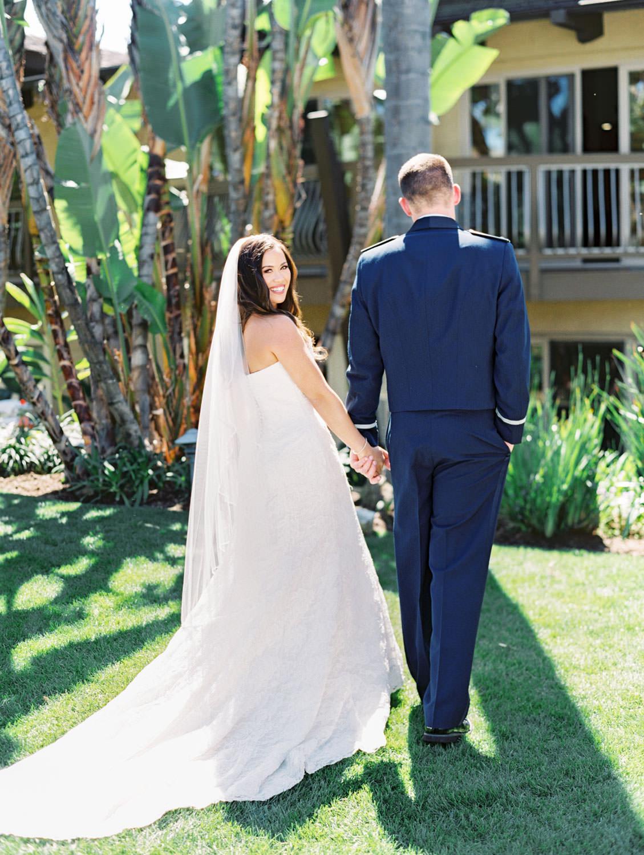 Bride and groom walking portrait on film. Wedding at Humphreys Half Moon Inn by Cavin Elizabeth Photography