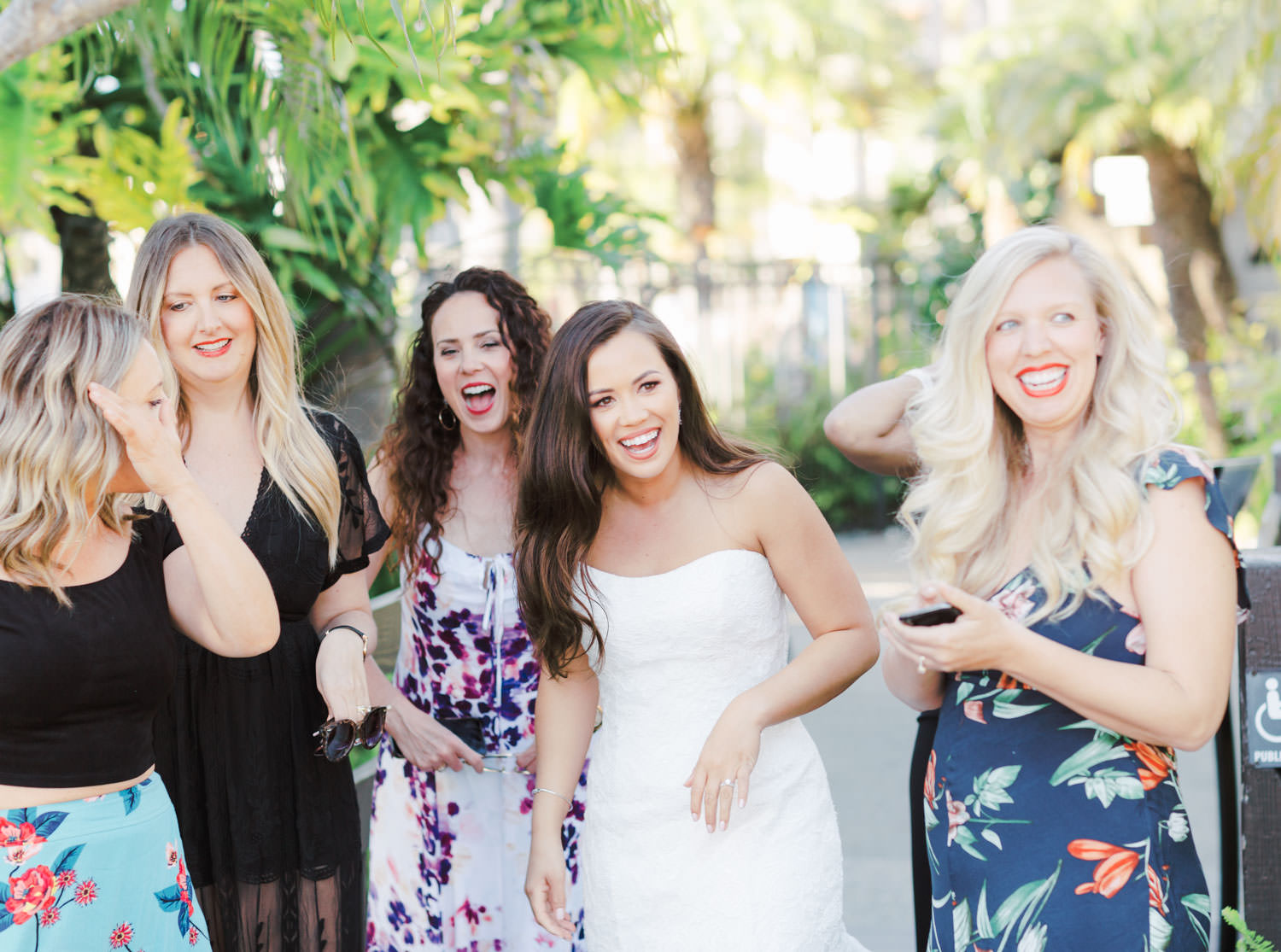 Bride laughing with guests during wedding reception. Wedding at Humphreys Half Moon Inn by Cavin Elizabeth Photography