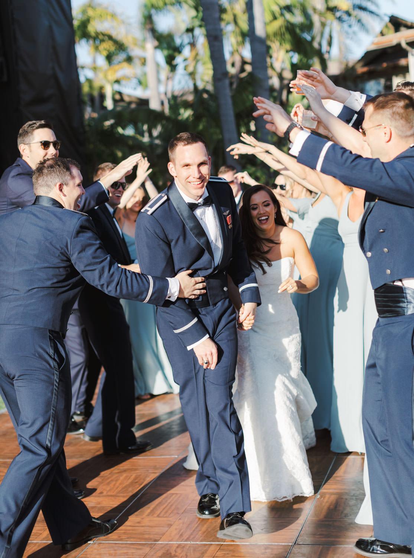 Bride and groom running through bridal party tunnel. Wedding at Humphreys Half Moon Inn by Cavin Elizabeth Photography