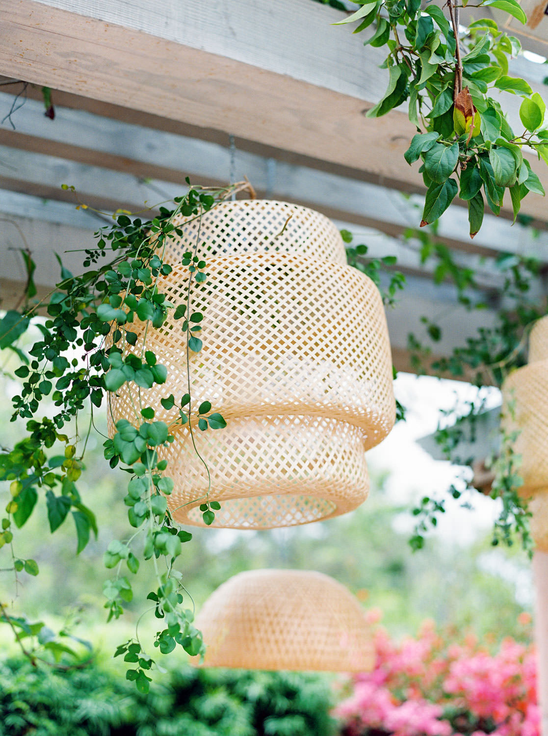 Beehive style hanging lantern with greenery. Beekeeper Inspired Wedding at Rancho Valencia on film by Cavin Elizabeth Photography