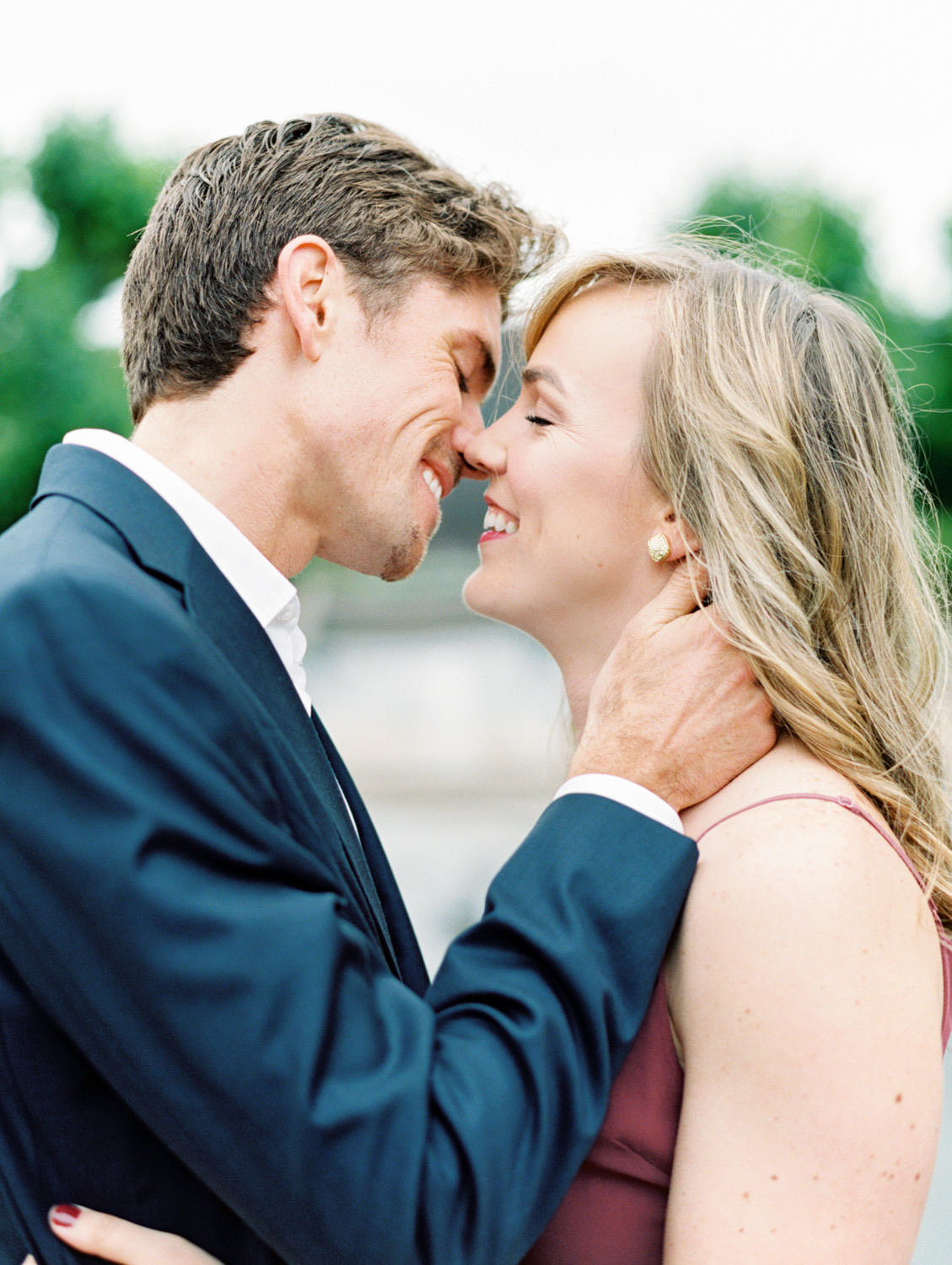 Bride in a deep mauve dress and groom in navy suit kissing. Film Engagement Photos at Golden Gate Park by Cavin Elizabeth