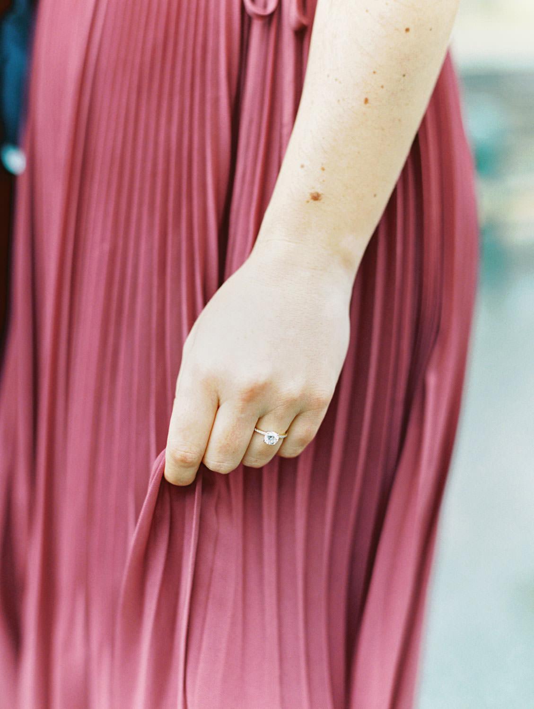 Bride in a deep mauve dress showing off engagement ring. Film Engagement Photos at Golden Gate Park by Cavin Elizabeth