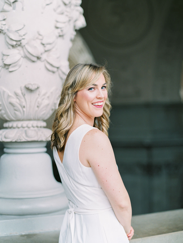 Bride in white linen jumpsuit. Film Engagement Photos at San Francisco City Hall by Cavin Elizabeth