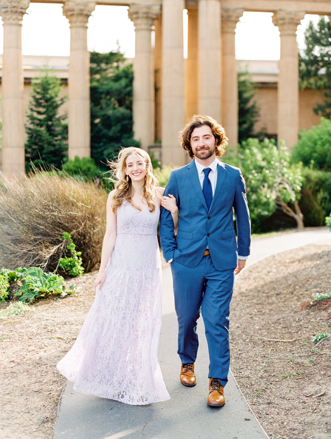 Blue suit and lavender lace dress, Palace of Fine Arts Engagement Session in San Francisco captured on film by Cavin Elizabeth