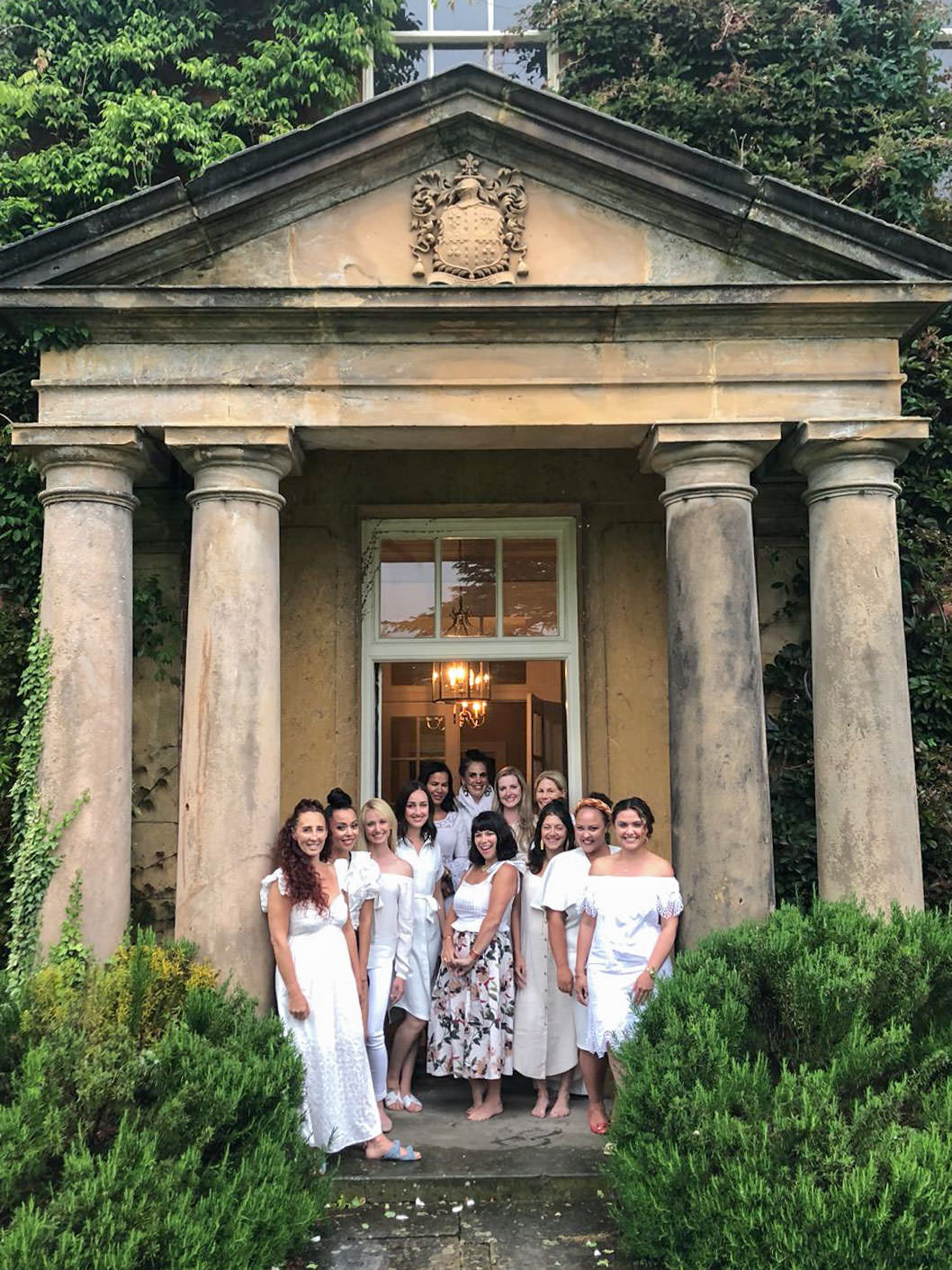 Flutter Magazine Retreat in the Cotswolds at Norton Hall. Women wearing all white for a farewell dinner