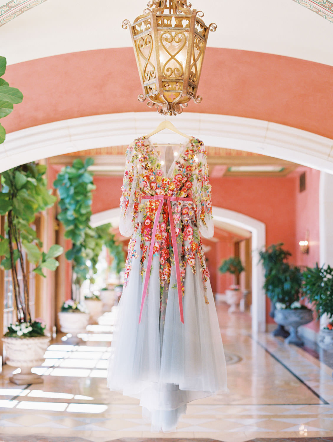 Marchesa blue and pink floral long sleeve couture gown with floral appliques. Fairmont Grand del Mar wedding published on Martha Stewart Weddings