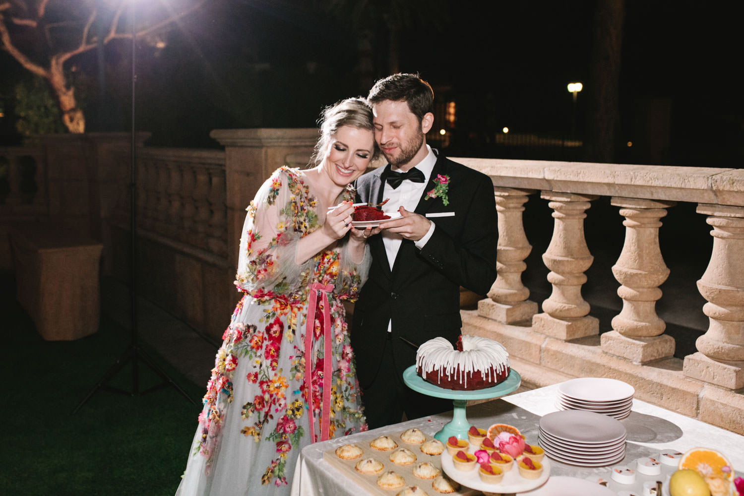 Bride and groom cutting red velvet nothing bundt cakes cake