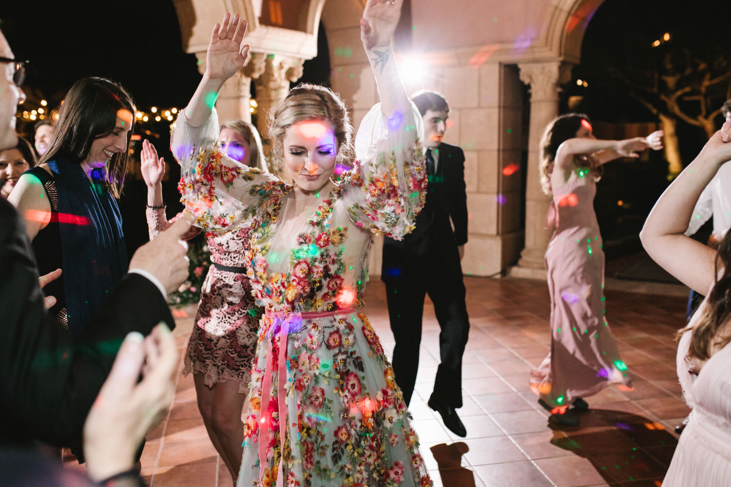 Bride on the dancefloor wearing colorful Marchesa wedding gown with blue, pink, yellow, green, and orange floral appliques. A Wedding Photographer's Fairmont Grand Del Mar Wedding