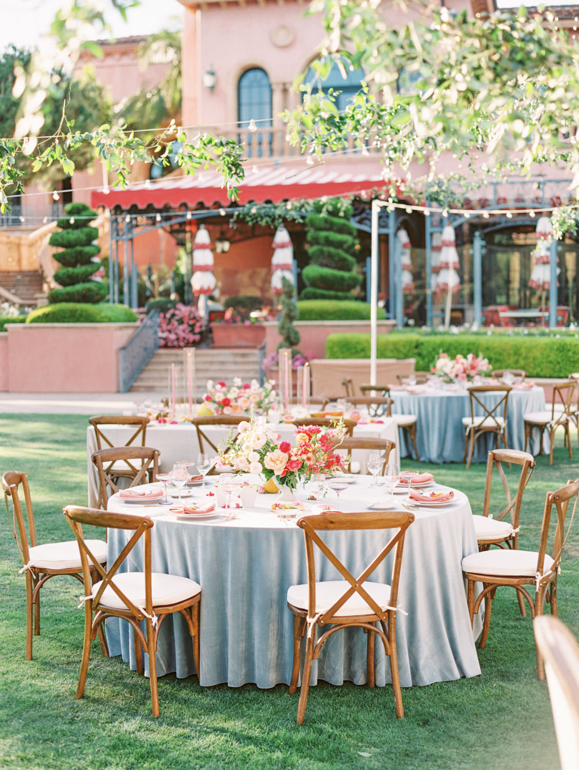 Al fresco reception with table covered in blue velvet linen with crossback chairs. A Wedding Photographer's Fairmont Grand Del Mar Wedding