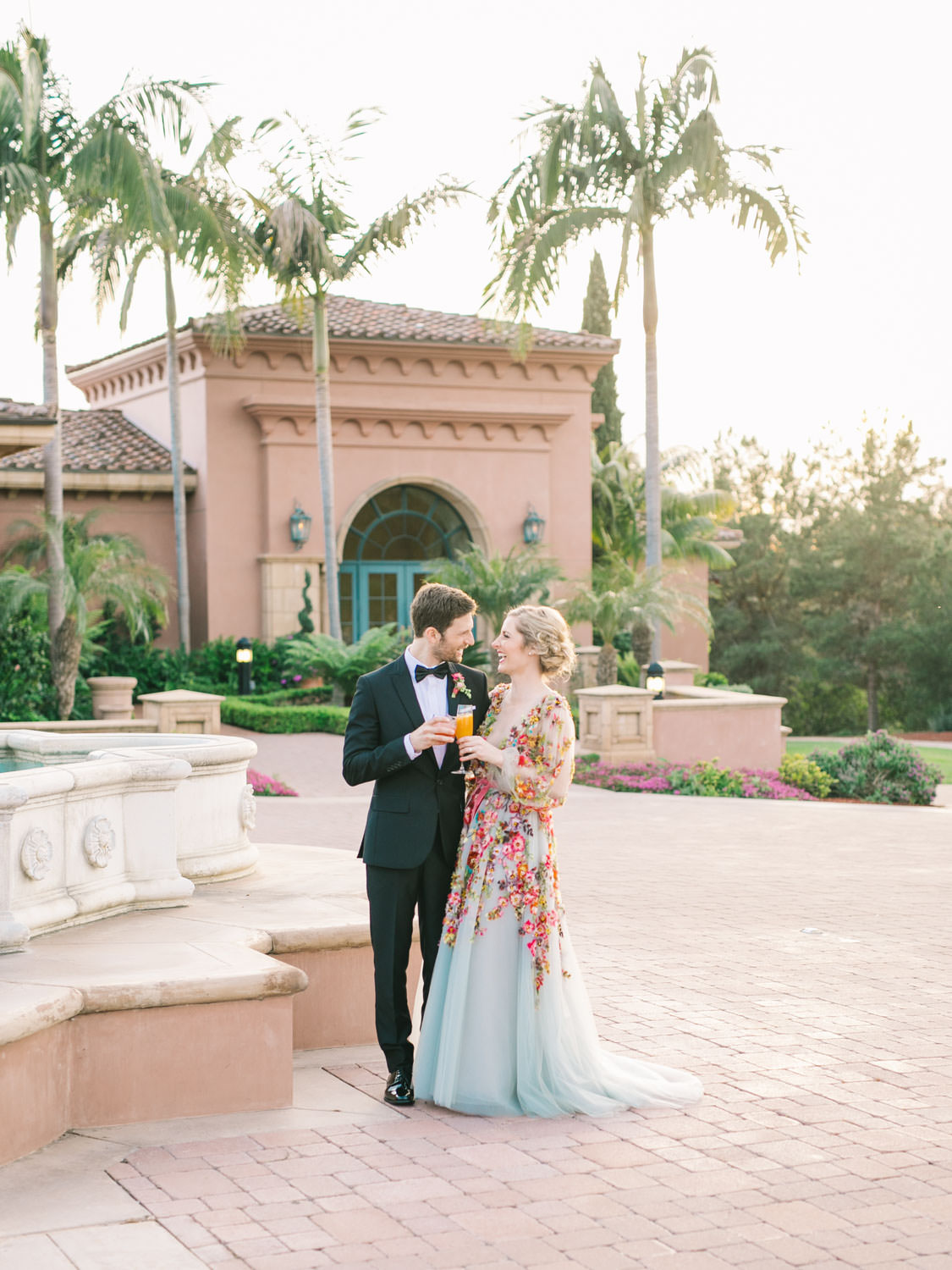 Bride and groom sunset portraits with signature cocktails. Bride wearing colorful Marchesa wedding gown with blue, pink, yellow, green, and orange floral appliques. A Wedding Photographer's Fairmont Grand Del Mar Wedding