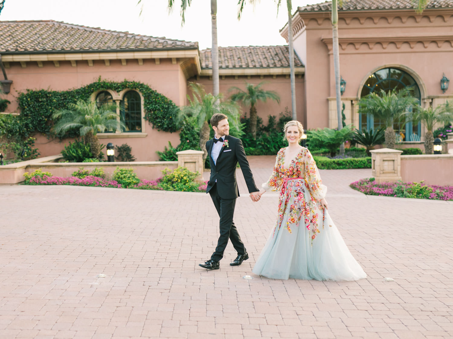 Bride and groom sunset portraits. Bride wearing colorful Marchesa wedding gown with blue, pink, yellow, green, and orange floral appliques. A Wedding Photographer's Fairmont Grand Del Mar Wedding