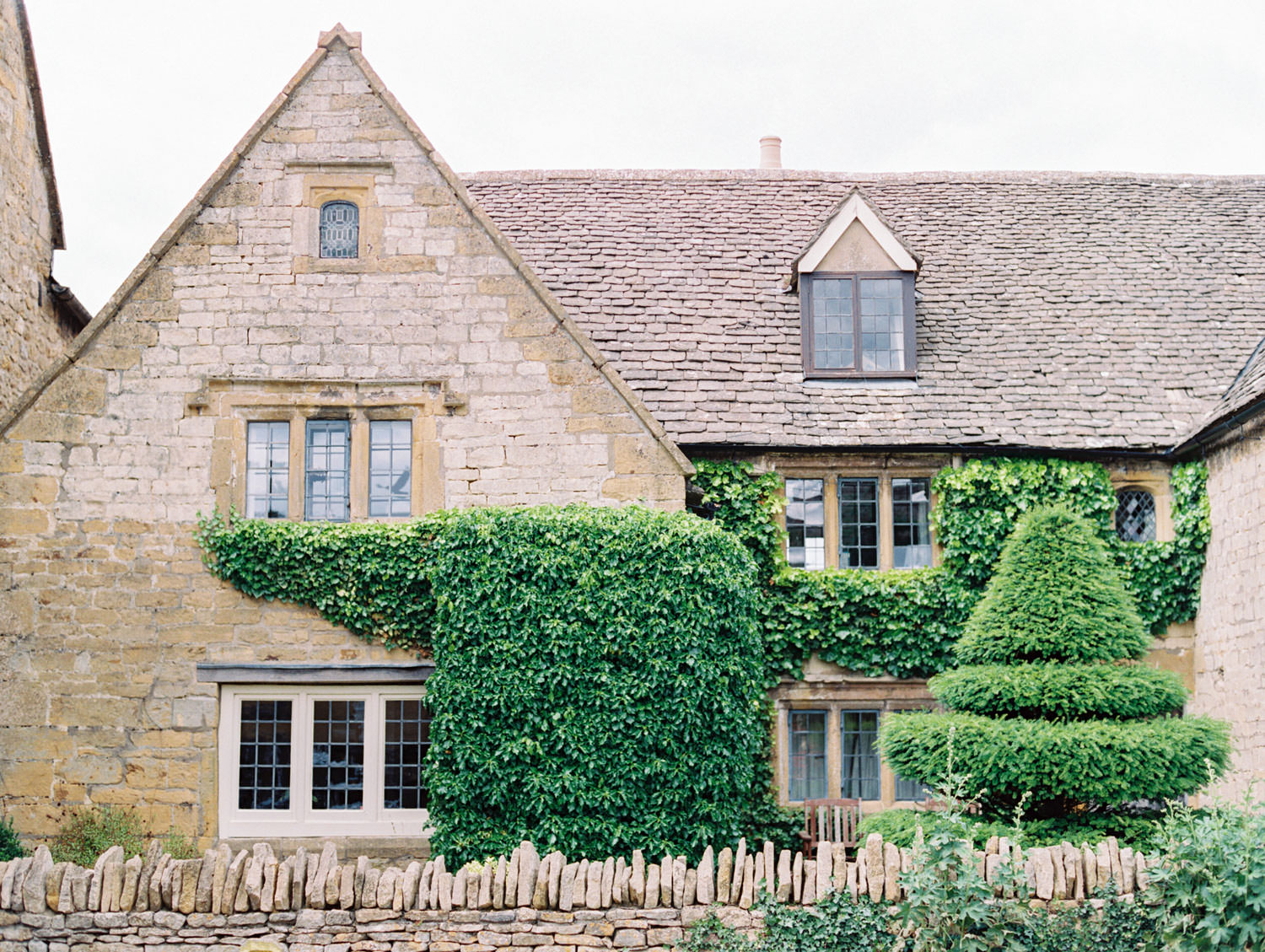 Broadway village house in the Cotswolds. Flutter Magazine Retreat in the Cotswolds at Norton Hall in Mickleton, England. Photo by Cavin Elizabeth Photography on film