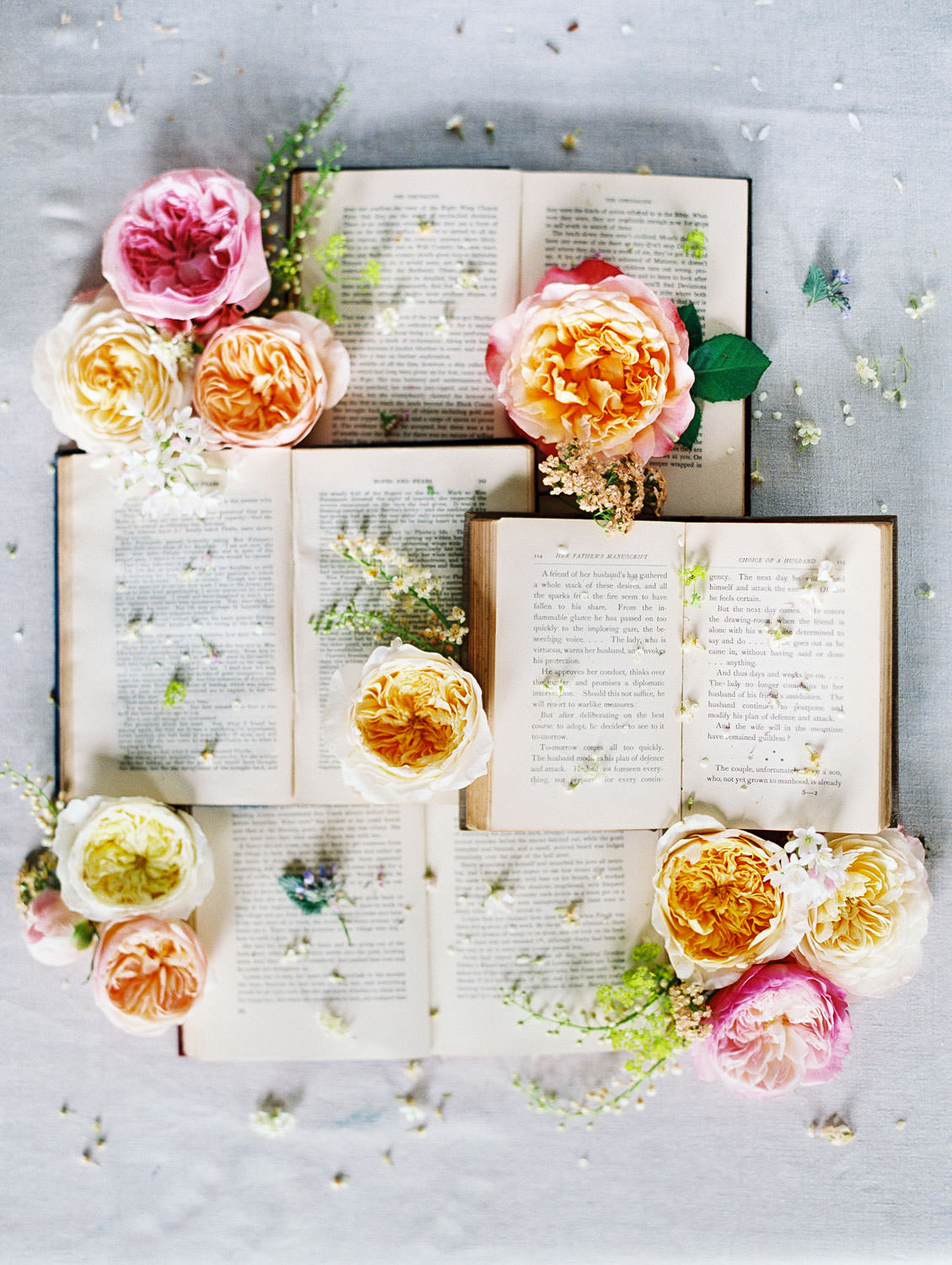 Vintage books stacked and styled with fresh flowers by Social and Co Events photographed by Cavin Elizabeth Photography on film