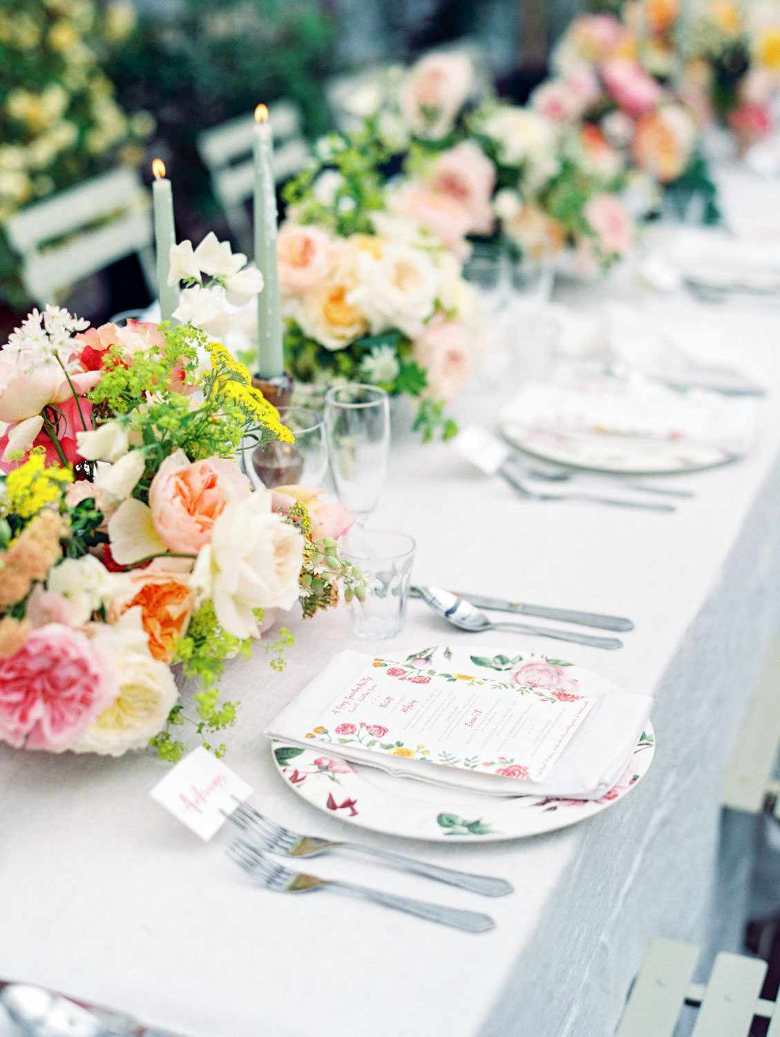 Pink, yellow, orange, muted teal, and white tablescape for lunch at David Austin Roses by Joy Proctor, Bows and Arrows flowers, Rosie Harbottle menus on the Flutter Magazine Retreat in the Cotswolds