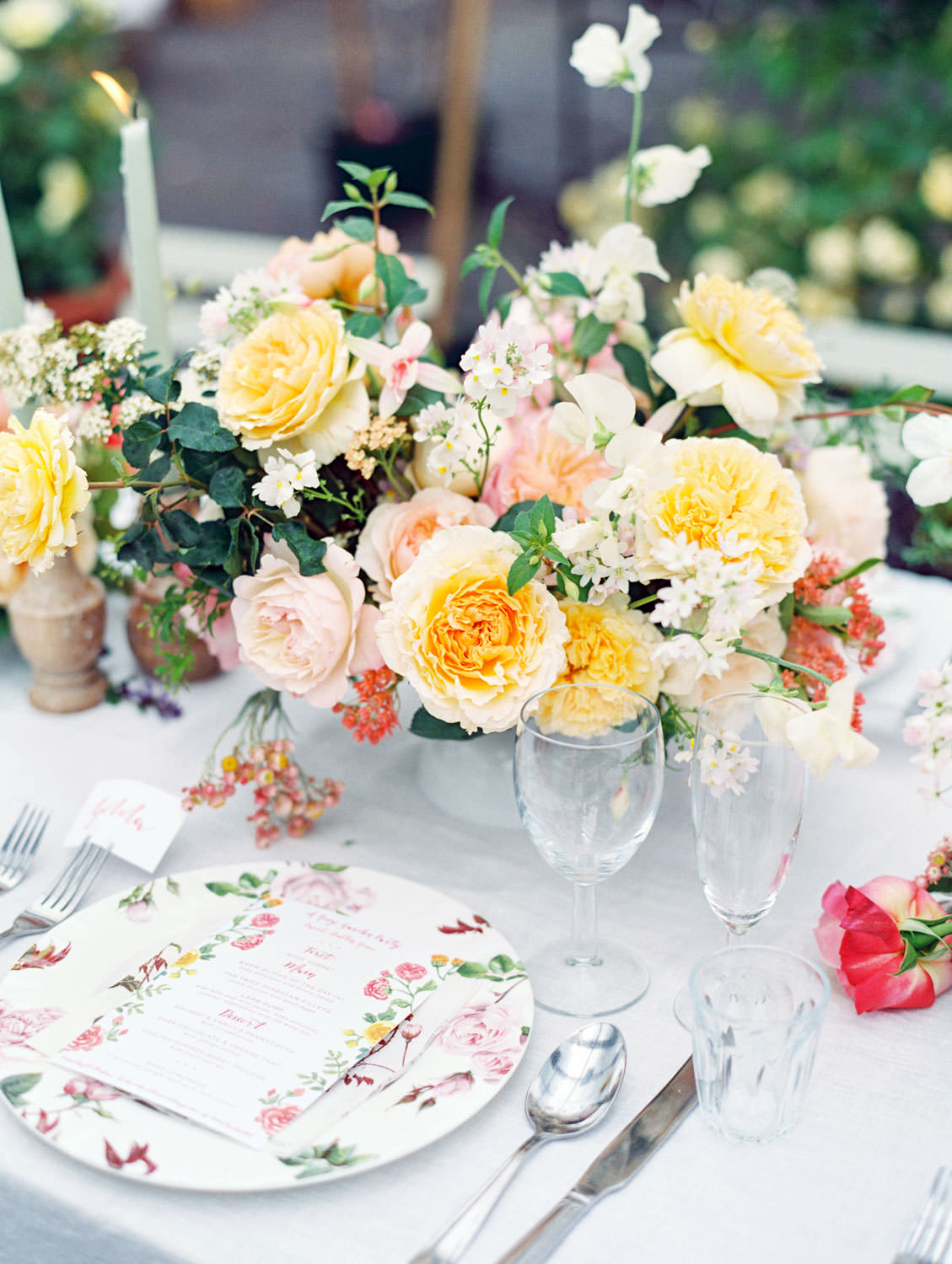 Pink, yellow, orange, muted teal, and white floral themed tablescape for lunch at David Austin Roses by Joy Proctor, Bows and Arrows flowers, Rosie Harbottle menus on the Flutter Magazine Retreat in the Cotswolds