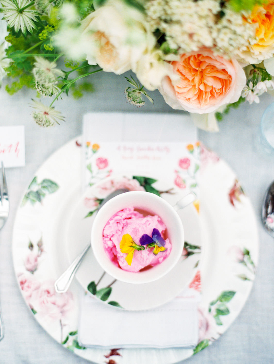 Pink sorbet appetizer. Pink, yellow, orange, muted teal, and white floral themed tablescape for lunch at David Austin Roses by Joy Proctor, Bows and Arrows flowers, Rosie Harbottle menus on the Flutter Magazine Retreat in the Cotswolds