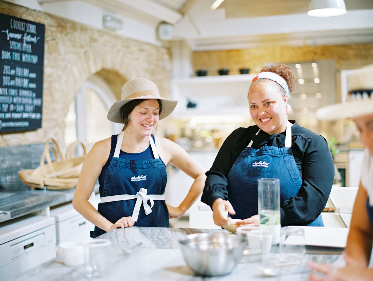 Daylesford Farm women making pasta dough during a cooking lesson. Flutter Magazine Retreat in the Cotswolds, England. Photo by Cavin Elizabeth Photography on film