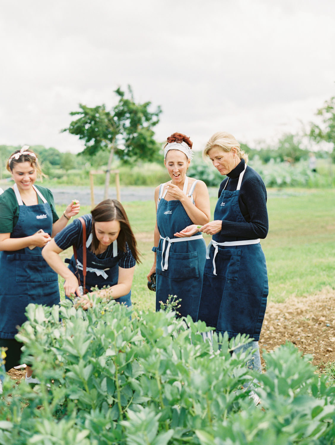 Daylesford Farm women foraging in the gardens. Flutter Magazine Retreat in the Cotswolds, England. Photo by Cavin Elizabeth Photography on film