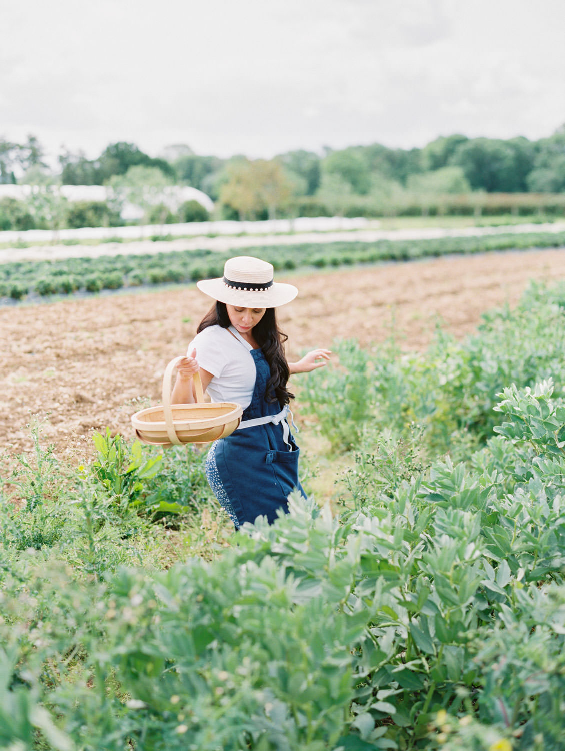 Daylesford Farm woman foraging in the gardens. Flutter Magazine Retreat in the Cotswolds, England. Photo by Cavin Elizabeth Photography on film